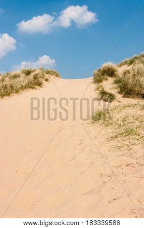 High sand dunes on a sunny day in Norfolk United Kingdom