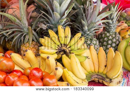 Assortment of fresh organic fruits. Frame composition of fruits on market stall