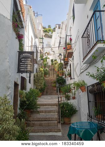 A steep climb up the cobbled steps in the village of Frigiliana in Andalusia Spain