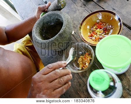Thai Fat Man Older Cooking And Seasoning Spicy Seafood Sauce Thai Style In Local Kitchen At House