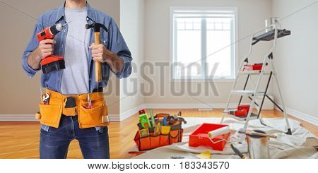 Construction worker with drill and hammer