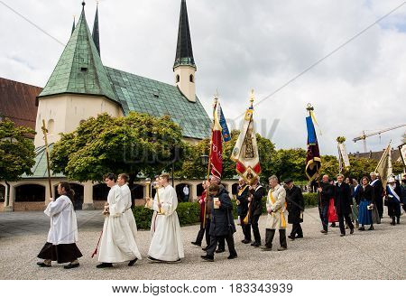 Altoetting,Germany-April 23,2017: A procession on St Konrad von Parzham day makes its way after Sunday mass