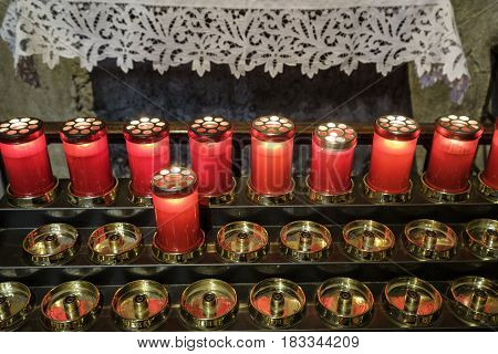 Agliate Brianza (Monza Lombardy Italy): interior of the medieval church of Saints Peter and Paul built from the 11th century candles