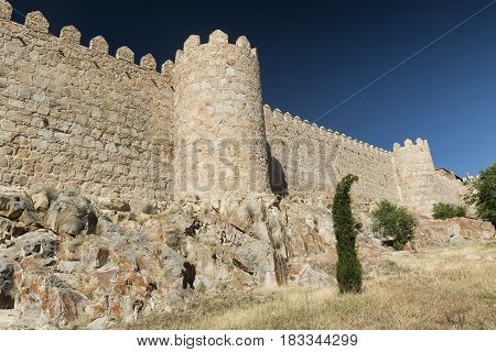 Avila (Castilla y Leon Spain): the famous medieval walls surrounding the city.