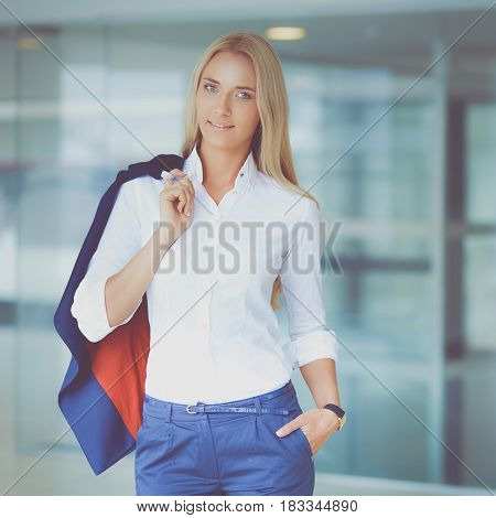 Young business woman standing in business center.
