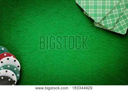 Cards and chips on green felt casino table. Abstract background with copy space. Gambling poker casino and cards games theme