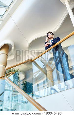 Modern businessman speaking on cellphone during travel