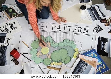 Woman working on banner on floor network graphic overlay