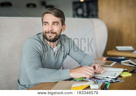 Happy businessman thinking of new ideas