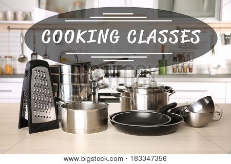 Cooking classes concept. Kitchen cookware on wooden table