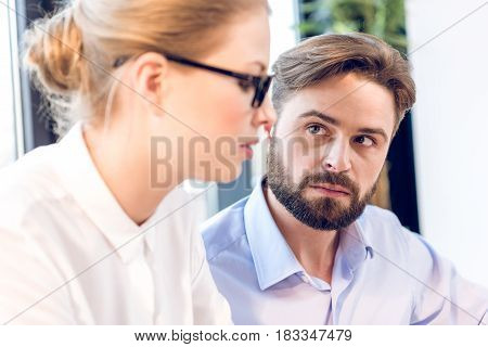 Close Up Of Concentrated Businessman And Businesswoman With Eyeglasses Working In Office