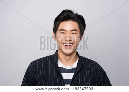Attractive smiling young asian man. Elegant young handsome asian man.