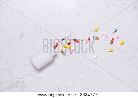 Colored Pills With Bottle  On Table. Flat Lay.