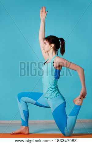 Photo of woman practicing yoga in hall