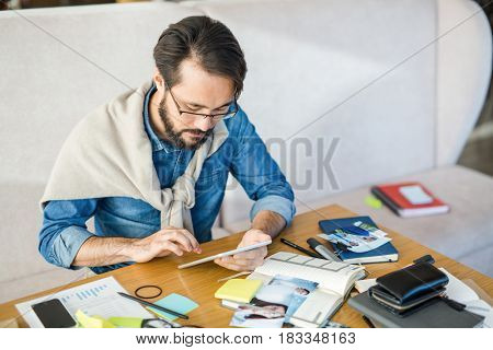 Creative designer with touchpad working in the net