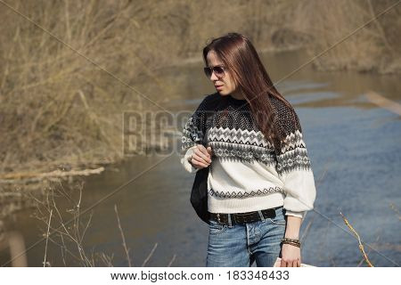 Woman Stands Near The River, Soft Focus Background
