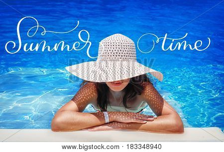 young woman in white hat resting in pool and text Summer time. Calligraphy lettering hand draw.