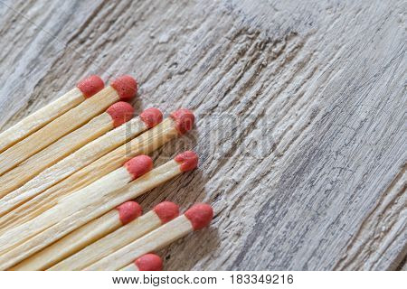 Raw of matches on wooden surface, close-up