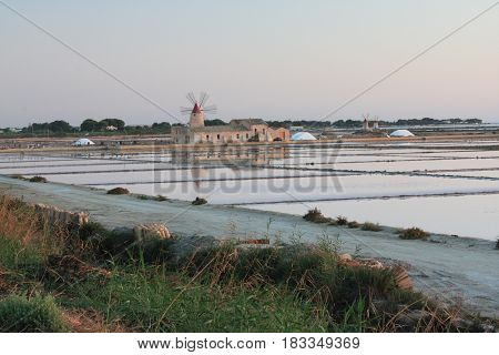 Mozia salt flats and an old windmill in Marsala, Sicily