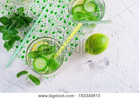 Glasses With Detox Fresh Organic Cucumber, Lemon And Mint Water On White Table