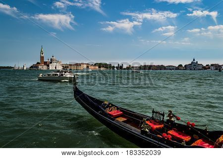 Venetian gondola and the panorama of San Giorgio Maggiore viewed from the main island