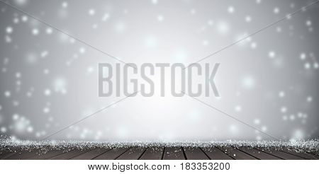 Wood table top on blur Christmas tree and white bokeh in snowfall background