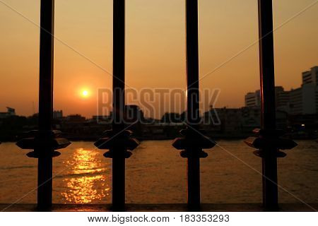 Silhouette Fence with Sunset at Chaophraya River Background.
