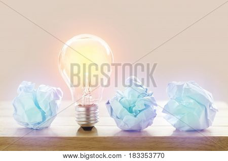light bulb and paper concept in think different and idea