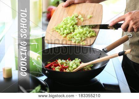 Cooking school concept. Man preparing vegetables in pan