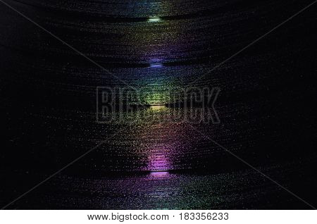 Close up of vinyl record with colour reflections