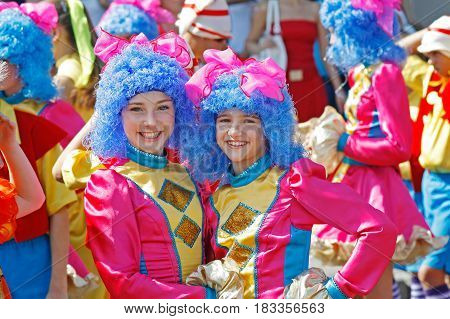 Volgograd Russia - September 07 2008: Two girls wearing bright costumes and blue wigs in carnival parade at the City Day in Volgograd