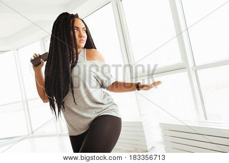 Feel the rhythm. Bright sensual artistic lady having some free time and spending it in bright dance class enjoying her hobby