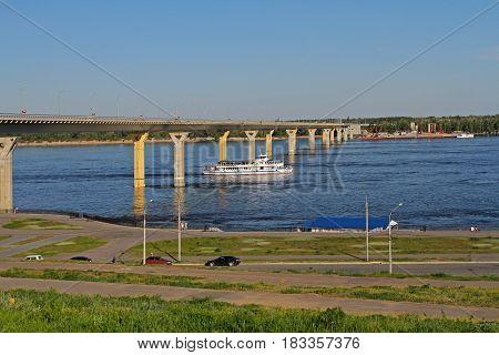 Volgograd Russia -May 09 2013: Pleasure boat under the bridge through the Volga River in Volgograd