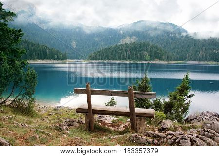 Relax. Rest near lake. Bench near lake. Beautiful mystical lake. Black Lake, Durmitor National Park. Montenegro