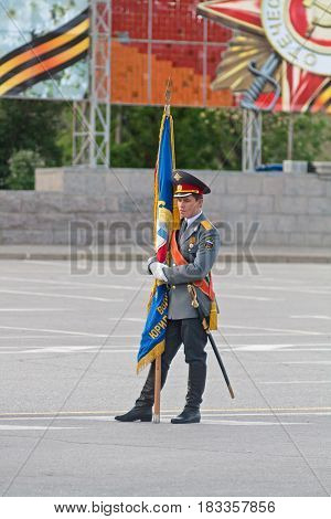Volgograd Russia - May 07 2012: Lone standard-bearer with flag at the dress rehearsal of Military Parade on 67th anniversary of Victory in Great Patriotic War on Victory day in Volgograd