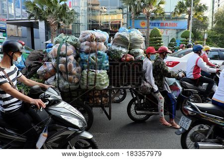 Overloaded Transportation By Motorbike