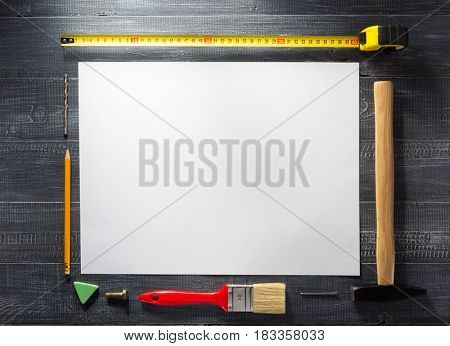 paper sheet and tools at wooden  background texture