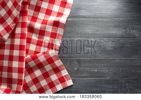 cloth napkin checked on wooden background