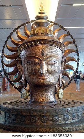 DELHI, INDIA - FEBRUARY 19: Surya, the resplendent one by Satish Gupta, golden statue, Airport of Delhi on February 19, 2016. Indira Gandhi International Airport is the 32th busiest in the world.