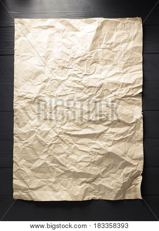 crumpled paper at wooden background
