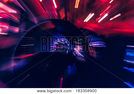 Blurred Lights In Moviment Of A Fast Car Running On The Street