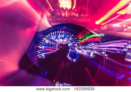 Car Dashboard With Speedometer On A Blurred Background
