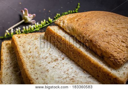 The Whole wheat bread image on wood table