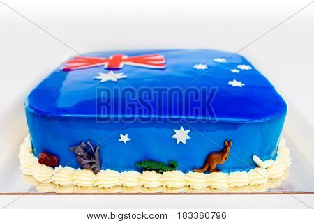 Home made Australia Day cake themed under colours of Australian Flag and decorated with koalas and kangaroos