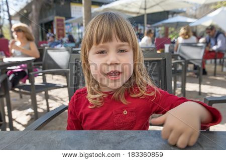 Child Looking At You Talking Sitting In Terrace