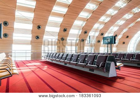 Paris, France, April 1, 2017: Empty airport terminal waiting area with chairs