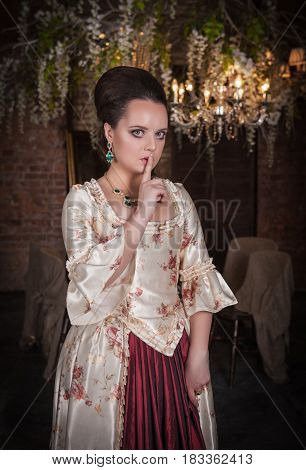 Beautiful Woman In Medieval Dress With Finger On Lips