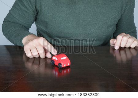 Man Finger Points A Toy Car