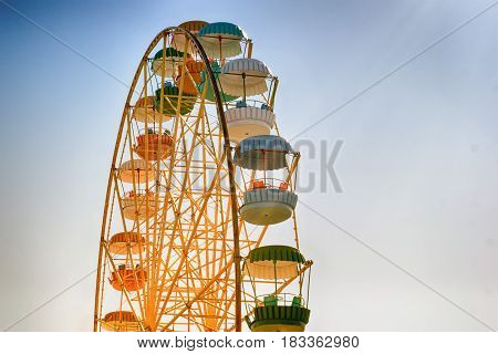Ferris Wheel-yellow With Multi-colored Booths