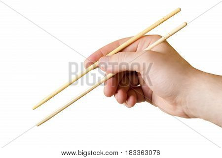 The image chopsticks in the man's hand isolated